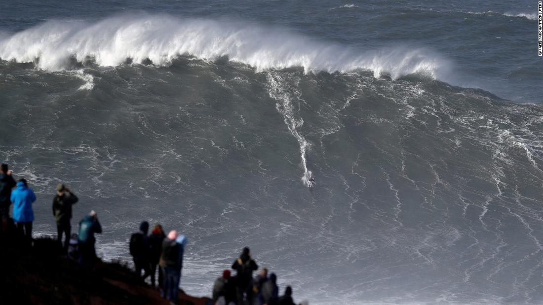 Big wave surfer Sebastian Steudtner of Germany rides a large wave at Praia do Notre on November 9, in Nazare, Portugal.