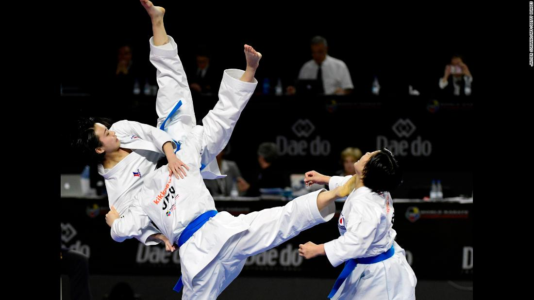 Japan's Saori Ishibashi, Mai Mugiyama and Sae Taira compete in the Kata team female final during the 24th Karate World Championships on November 11, in Madrid.