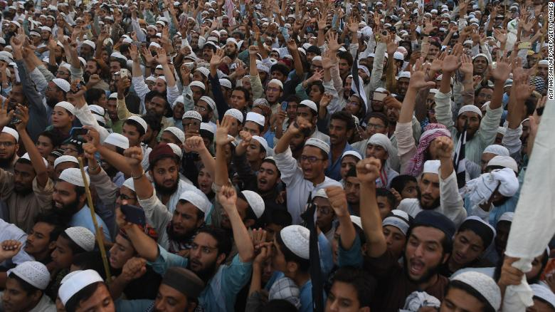 Supporters of the Pakistani religious Islamist group Mutahida Majlis-e-Amal (MMA) gather during a protest rally against the release of Asia Bib in early November.
