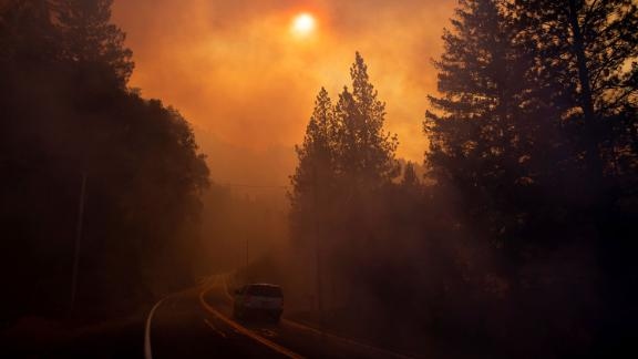 A vehicle drives through smoke near Pulga on Sunday, November 11.