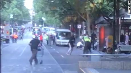 A still taken from video of the attack shows Rogers running with the shopping cart towards the attacker.