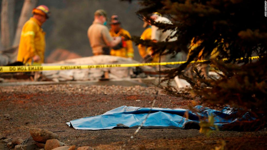 A bag containing human remains lies on the ground as officials continue to search for victims at a burned out home in Paradise, California, on Sunday, November 11.