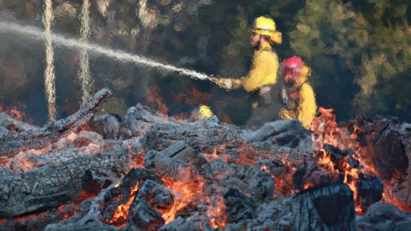 Firefighters work at the Salvation Army Camp in Malibu on Saturday, November 10.