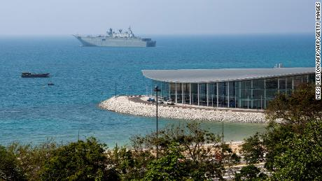 This photo taken on November 4, 2018, shows the Australian warship HMAS Adelaide moored off APEC Haus in Port Moresby, the host city for the upcoming Asia-Pacific Economic Cooperation (APEC) summit from November 17.