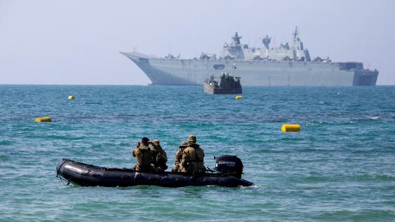 Australian warship HMAS Adelaide moored off Port Moresby, the host city for the upcoming APEC summit.
