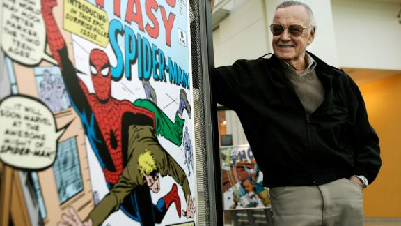 FILE - In this March 21, 2006 file photo, comic book creator Stan Lee stands beside some of his drawings in the Marvel Super Heroes Science Exhibition at the California Science Center in Los Angeles. The Walt Disney Co. on Monday, Aug. 31, 2009 said it is buying Marvel Entertainment Inc. for $4 billion in cash and stock, bringing such characters as Iron Man and Spider-Man into the family of Mickey Mouse and WALL-E.  (AP Photo/Damian Dovarganes, file)