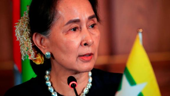 Myanmar's State Counselor Aung San Suu Kyi delivers a speech during a joint press announcement in Tokyo on October 9, 2018.