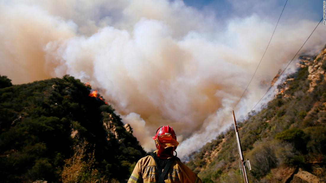 Firefighters battle the Woolsey Fire in Malibu on November 11.