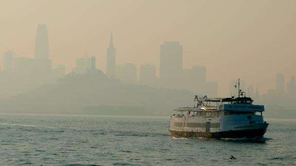 A ferry makes its way toward Alcatraz Island on November 12 as the San Francisco skyline is obscured by smoke that drifted over from the Camp Fire.