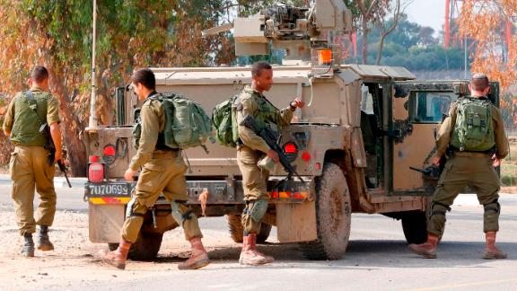 Israeli soldiers arrive near the Gaza fence on Monday.