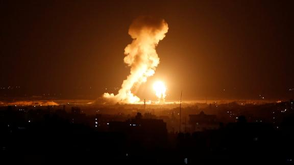 Smoke and flame are seen during an Israeli airstrike in Gaza.