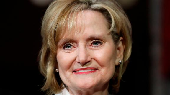 Mississippi Republican Cindy Hyde-Smith smiles during her ceremonial swearing-in at the Old Senate Chamber, Monday, April 9, 2018, in the Capitol in Washington. She was appointed by Mississippi Gov. Phil Bryant to succeed Sen. Thad Cochran, R-Miss., who resigned April 1 for health reasons.