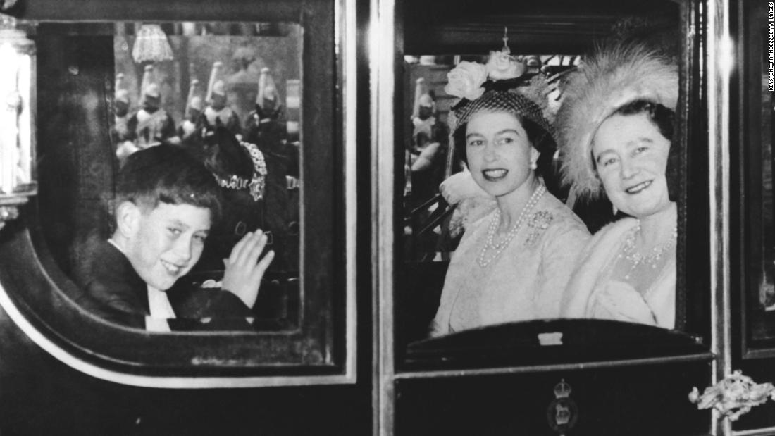Prince Charles rides with his mother and grandmother as they travel to Westminster Abbey for the wedding of Princess Margaret in May 1960.