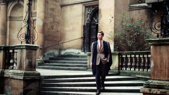 Prince Charles walks at Trinity College, Cambridge, where he earned a bachelor