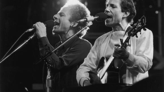 Simon and Garfunkel perform during a reunion concert at London