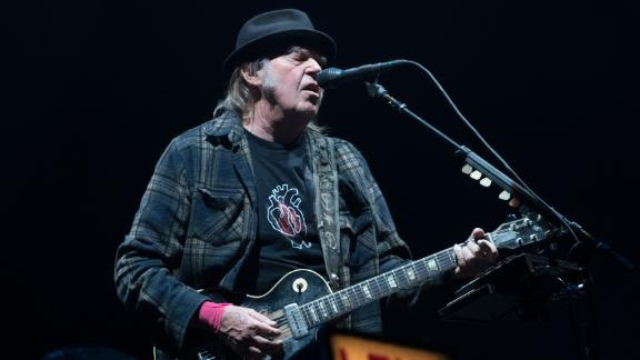 Neil Young performs on stage in 2018.  (Photo credit should read ALICE CHICHE/AFP/Getty Images)