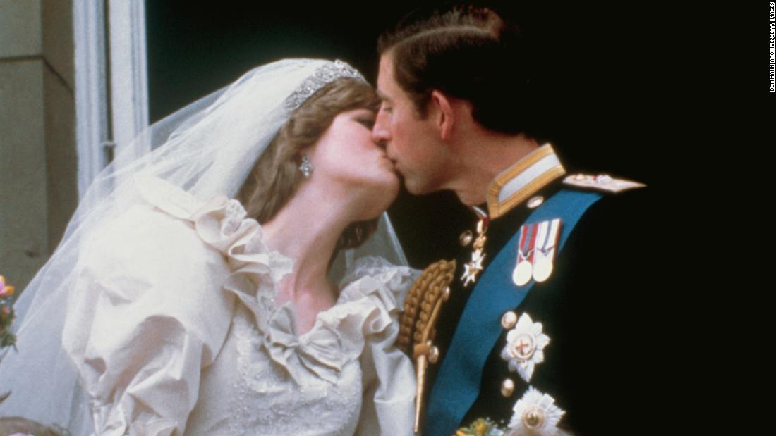 Prince Charles kisses his first wife, Lady Diana Spencer, on the balcony of Buckingham Palace in July 1981. Their wedding ceremony was televised.