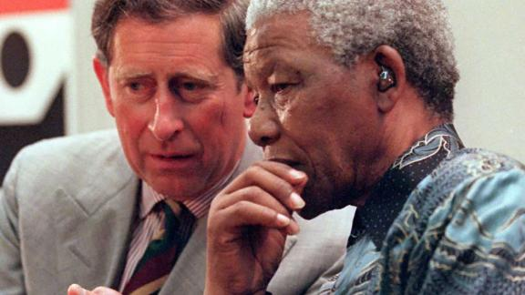 South African President Nelson Mandela talks with Prince Charles in London in July 1996.