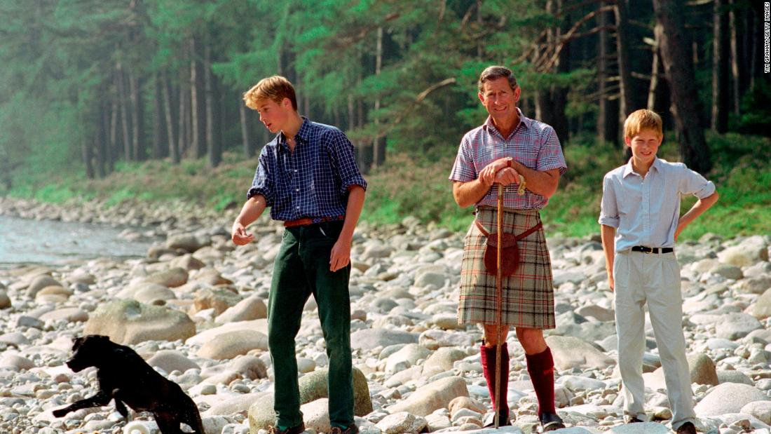 Prince Charles and his sons spend time together at the Balmoral Castle estate in Balmoral, Scotland, in August 1997.