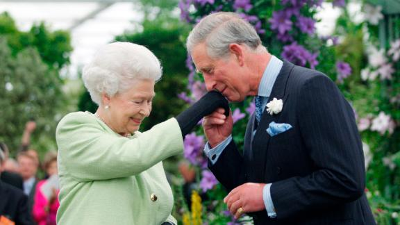 Queen Elizabeth II presents Prince Charles with the Royal Horticultural Society