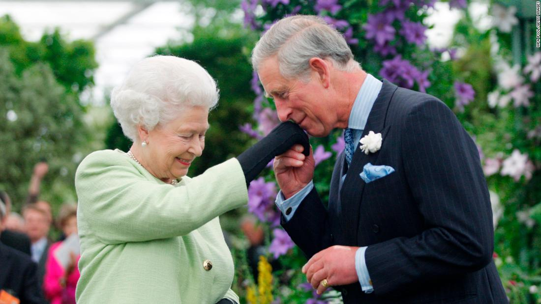 Queen Elizabeth II presents Prince Charles with the Royal Horticultural Society's Victoria Medal of Honor during a visit to the Chelsea Flower Show in London in May 2009.