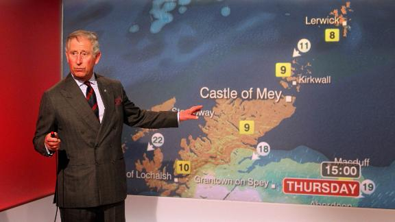 Prince Charles reads the weather while touring BBC Scotland