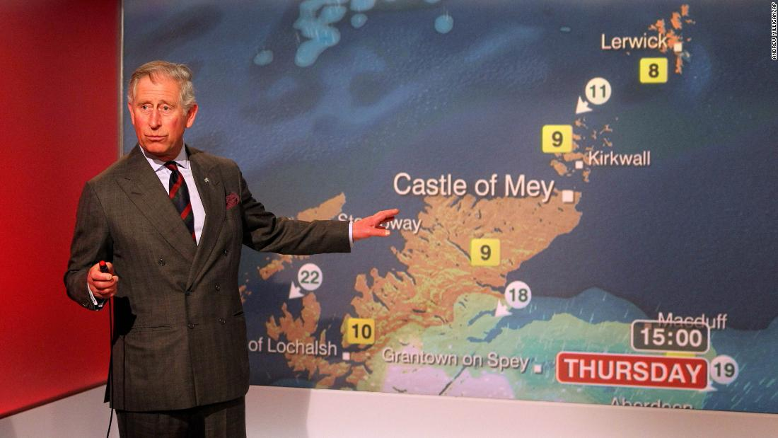 Prince Charles reads the weather while touring BBC Scotland's headquarters in May 2012.