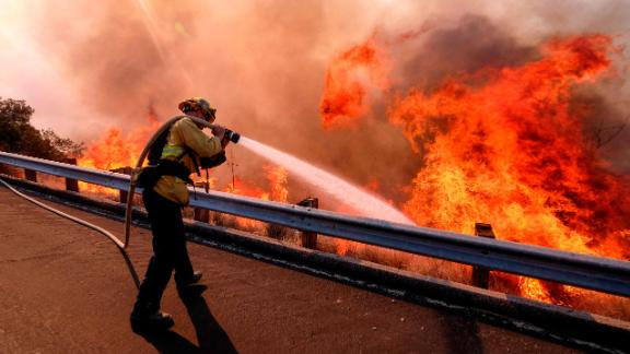 A firefighter battles a fire in Simi Valley on November 12.