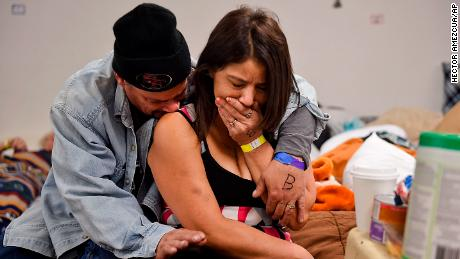 Joseph Grado and his wife, Susan Grado, embrace while staying at a shelter for fire evacuees in Chico, California. They lost their Paradise home in the Camp Fire.