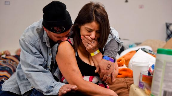 Joseph Grado and his wife, Susan, embrace at a shelter in Chico on November 12. The Camp Fire destroyed their home.
