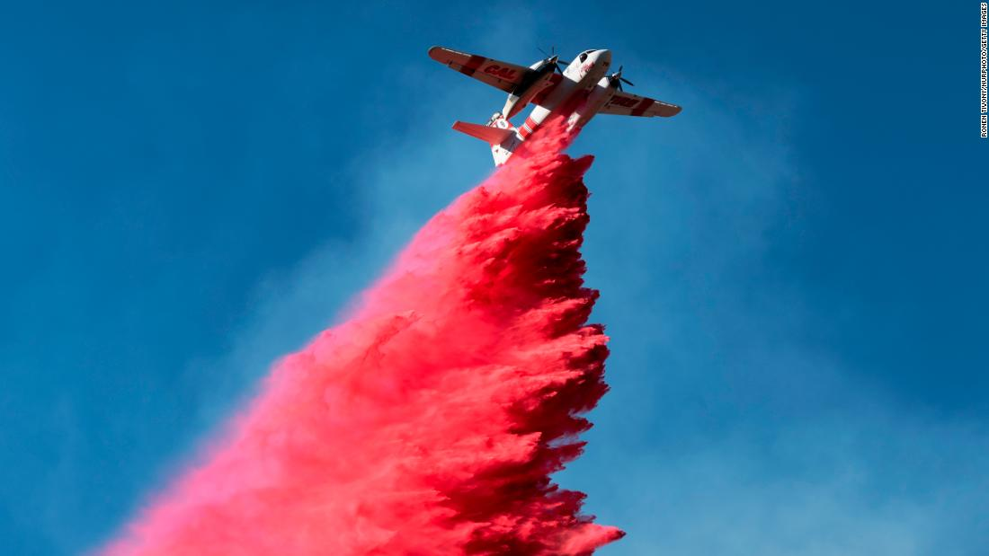 A plane drops fire retardant on the Woolsey Fire near Malibu on November 12.