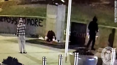 The security camera image released by police shows two alleged vandals by the statue on Friday morning.