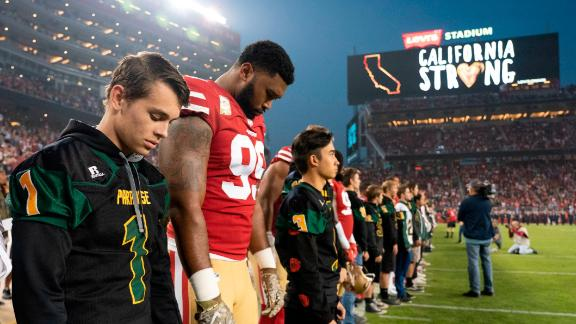 November 12, 2018; Santa Clara, CA, USA; San Francisco 49ers defensive tackle DeForest Buckner (99) and Paradise High School football players during a moment of silence before the game against the New York Giants at Levi's Stadium. Mandatory Credit: Kyle Terada-USA TODAY Sports
