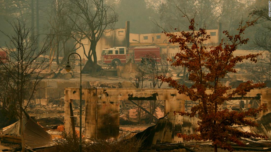 A fire truck drives through part of Paradise, California, on November 13.