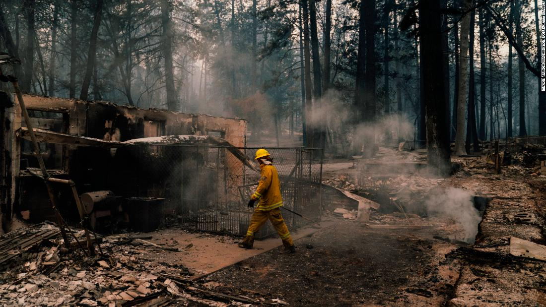 Firefighters put out hot spots in Paradise on November 12.