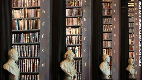 Male busts are displayed inside Trinity College's library in Dublin.