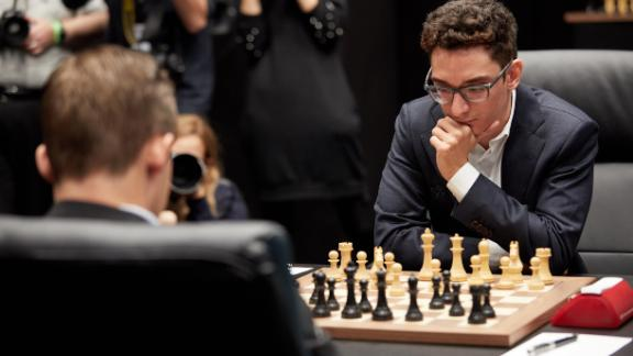 Caruana (right) plays world champion Carlsen over 12 matches in London this month.
