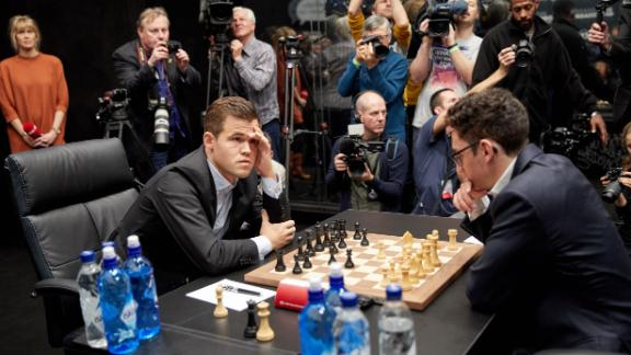 Magnus Carlsen (left) is reported to be worth more than $8M.