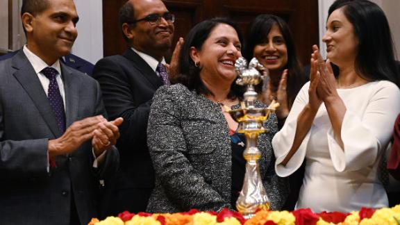 Trump administration regulatory czar Neomi Rao (C) reacts after US President Donald Trump announced his intent to nominate her to fill Brett Kavanaugh's former seat on the D.C. Circuit Federal Court of Appeals during the Diwali ceremonial lighting of the Diya at the White House in Washington, DC, on November 13, 2018.
