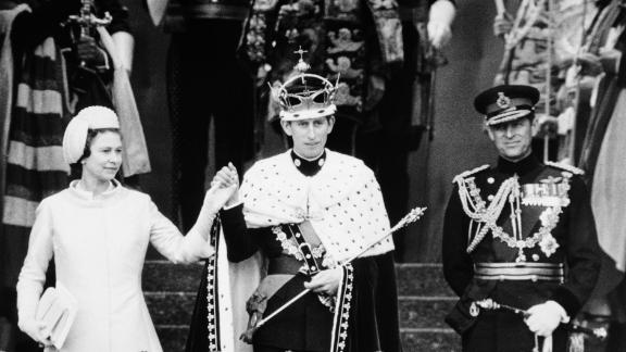 Queen Elizabeth II presents Prince Charles to the people of Wales after his investiture as the Prince of Wales in July 1969.
