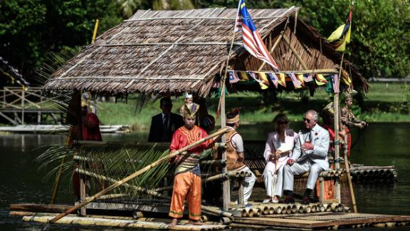Charles and Camilla ride on a raft while visiting the island of Borneo in November 2017.