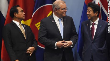 Thai Prime Minister Prayut Chan-O-Cha (left) looks on as Australia's Prime Minister Scott Morrison (center) talks with Japan's Prime Minister Shinzo Abe as they arrive to pose for a group photo in Singapore on November 14.