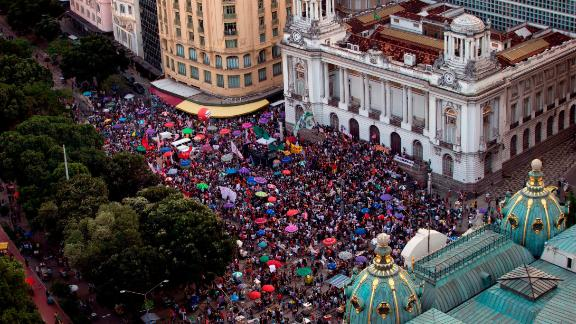 Demonstrators take part in a protest against  Jair Bolsonaro, called by a social media campaign under the hashtag #EleNao (NotHim), in Rio de Janeiro on October 20.