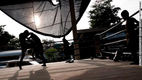 Thai lawmakers are trying to change the country's laws to protect young fighters.