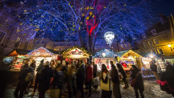 <strong>Bath, England:</strong> Shoppers browse stalls at the traditional Christmas market close to the historic Roman Baths.