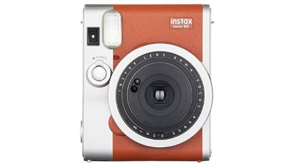 "<strong>Fujifilm Instax Mini 90 Instant Film Camera ($121.14; </strong><a href=""https://amzn.to/2qJW4aq"" target=""_blank""><strong>amazon.com</strong></a><strong>)</strong>"