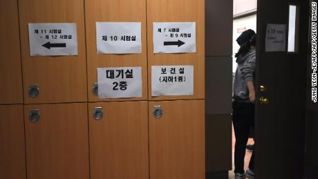 A student enters an exam room to take the annual College Scholastic Ability Test, a standardised exam for college entrance, at a high school in Seoul on November 23, 2017.
