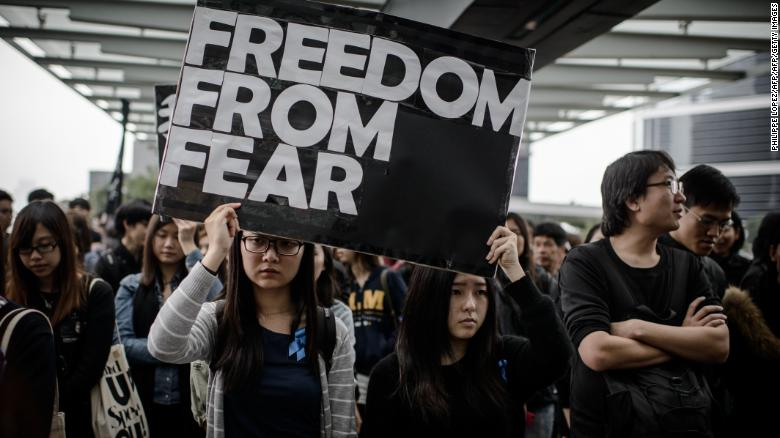 Protesters display placards during a rally  to support press freedom in Hong Kong on March 2, 2014.