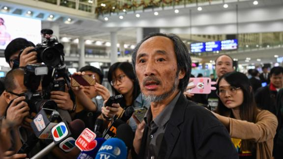 Chinese author Ma Jian speaks to the press upon his arrival at Hong Kong International Airport on November 9, 2018.
