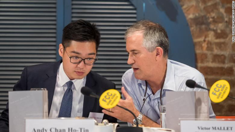 Victor Mallet, a Financial Times journalist and vice president of the Foreign Correspondents' Club (FCC) (right) speaks with Andy Chan, founder of the Hong Kong National Party, during a luncheon at the FCC in Hong Kong.